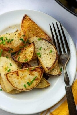 A plate of food with a fork, with Turnip