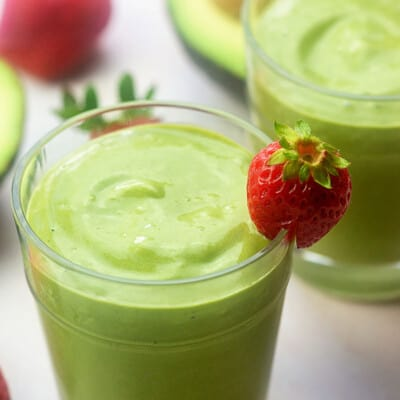 strawberry avocado smoothie in glass