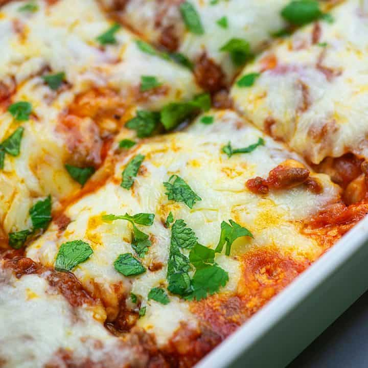 low carb lasagna in green casserole dish