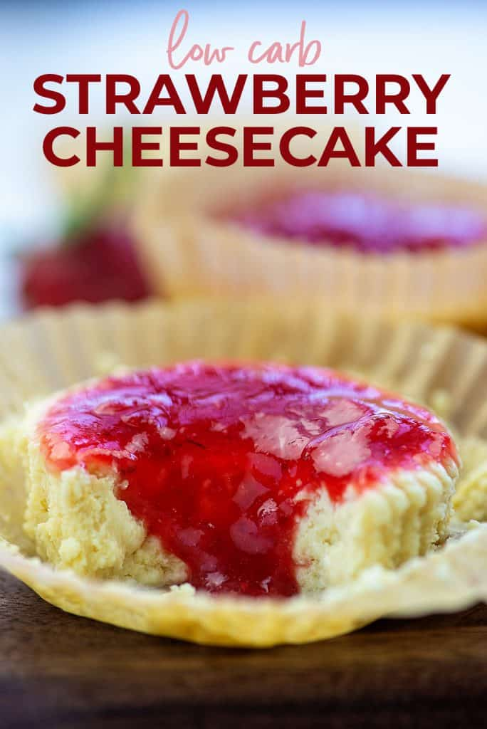 mini cheesecakes topped with strawberry sauce