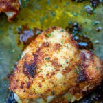 crispy chicken thighs on baking sheet