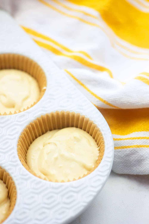 mini cheesecakes in muffin tin