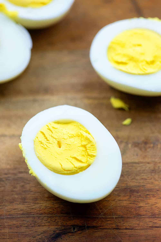 hard boiled eggs on cutting board