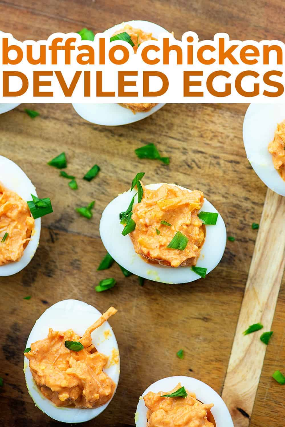 Several buffalo chicken deviled eggs on a wooden cutting board