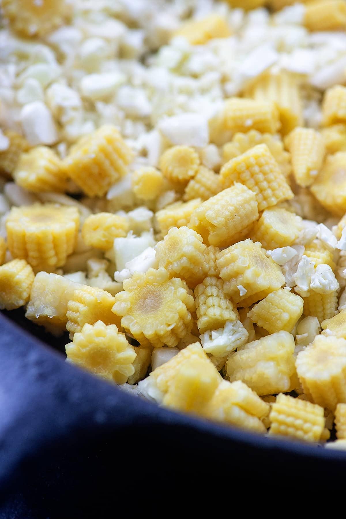 cauliflower and baby corn in cast iron skillet