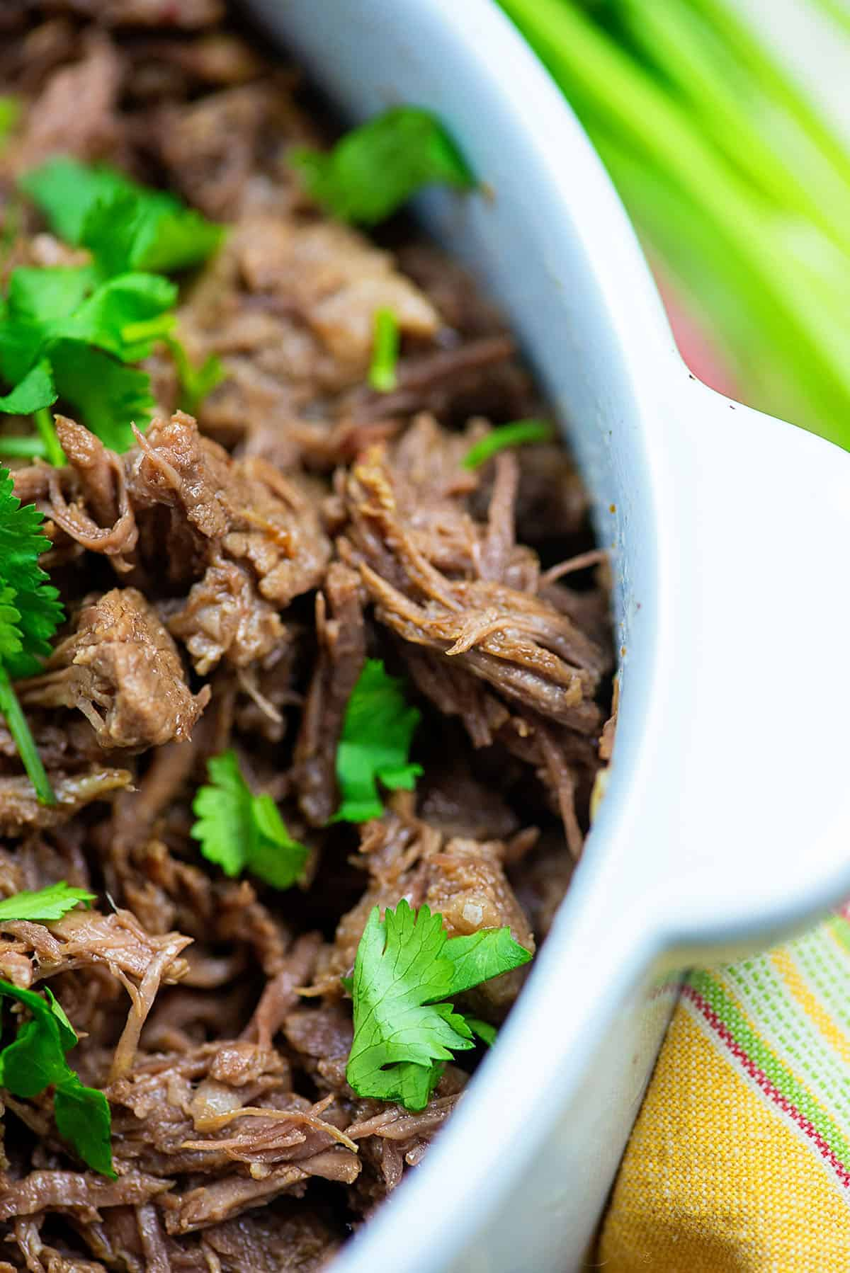 slow cooker barbacoa in white dish