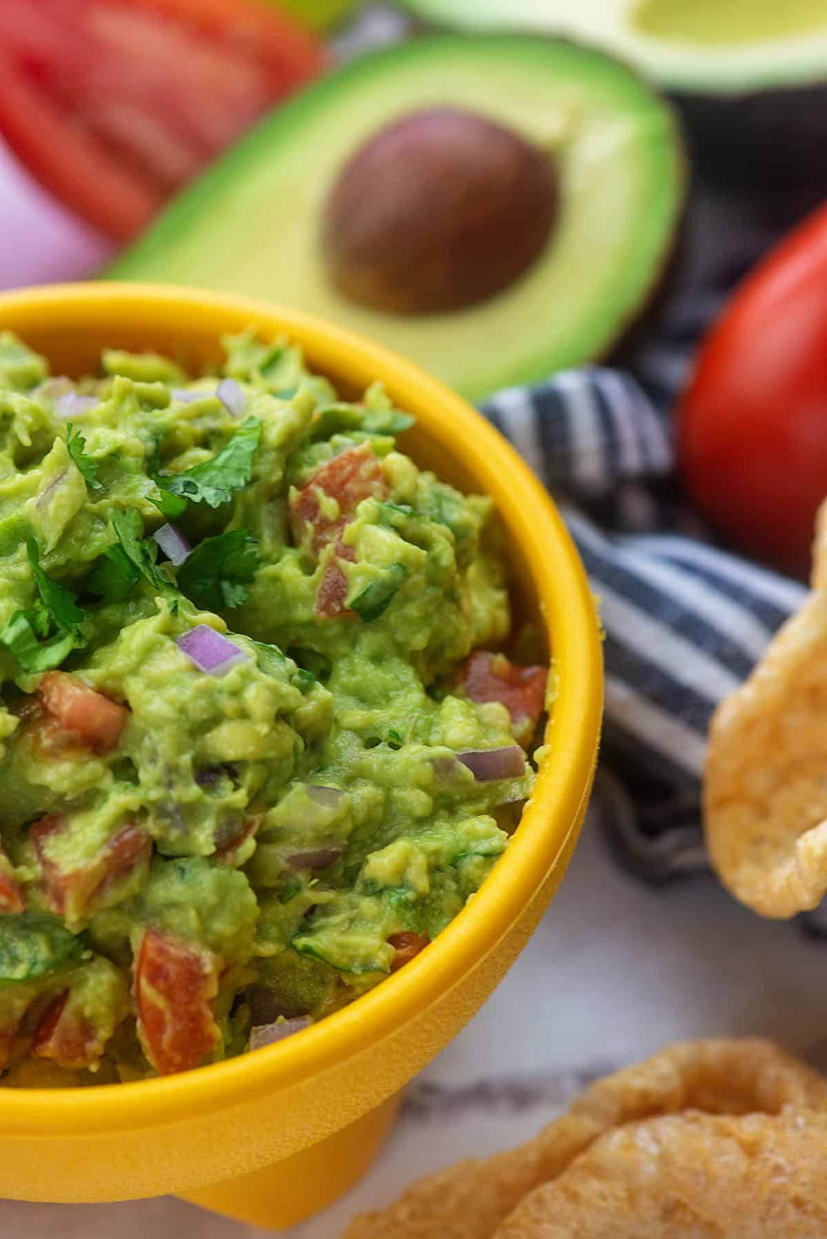 guacamole recipe with pork rinds in yellow bowl