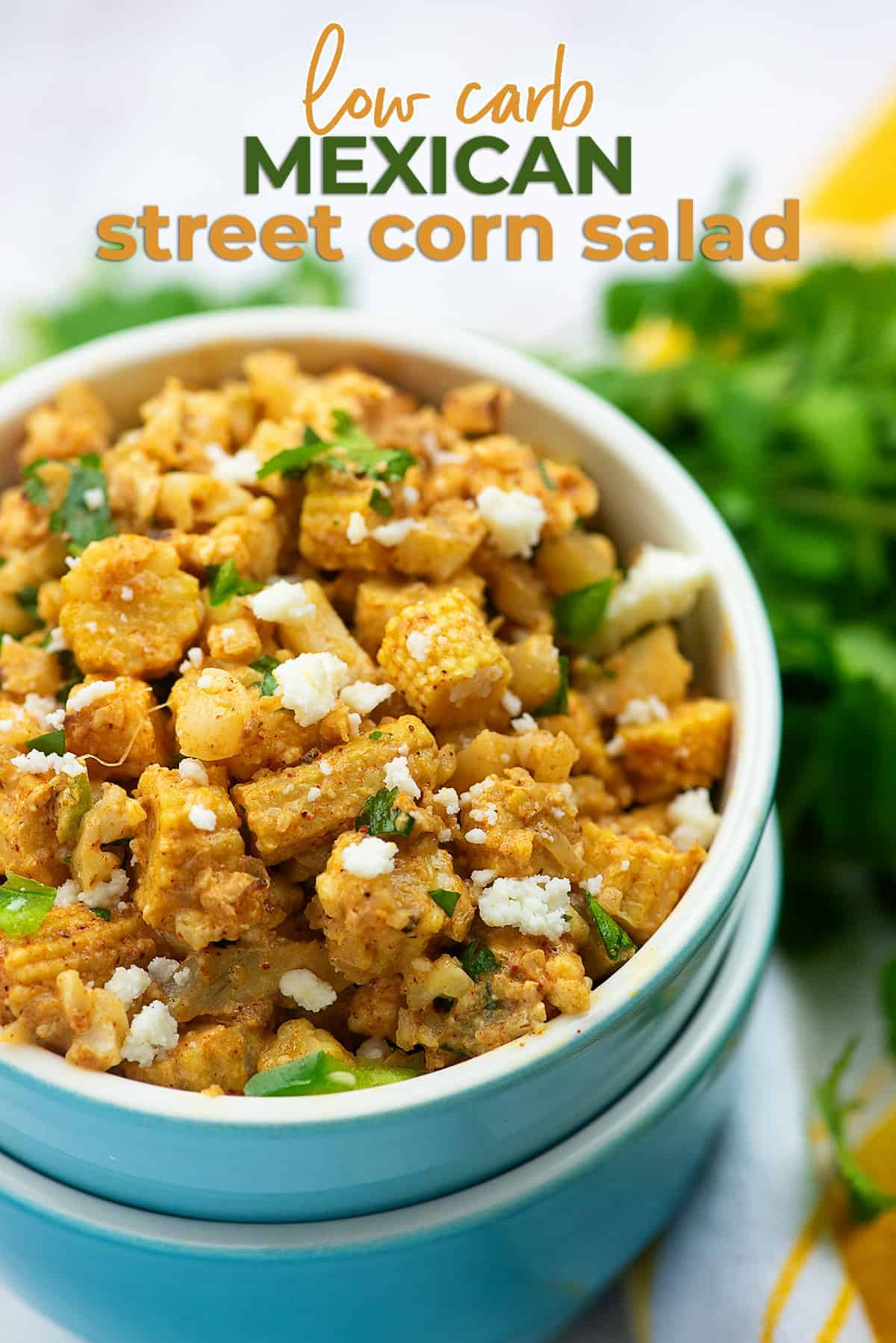 low carb Mexican street corn salad in blue bowls