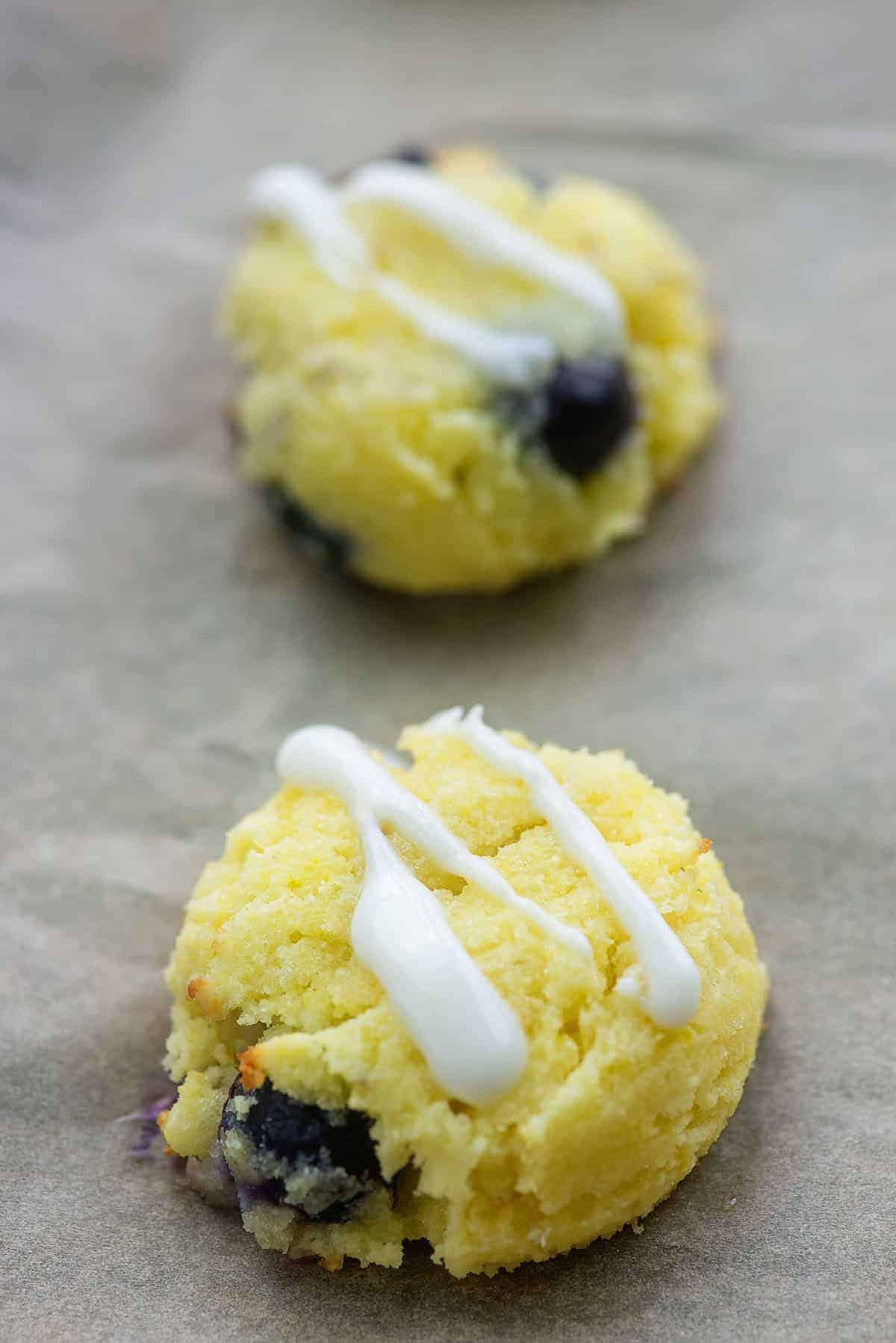 blueberry glazed cookies on baking sheet