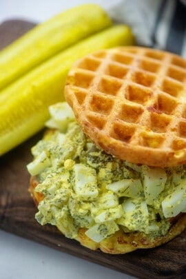 A close up of egg salad on a chaffle.