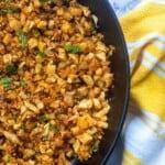 mexican cauli rice recipe in cast iron skillet