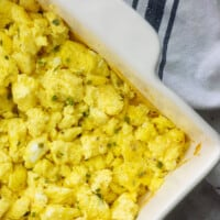 oven baked scrambled eggs in white baking dish