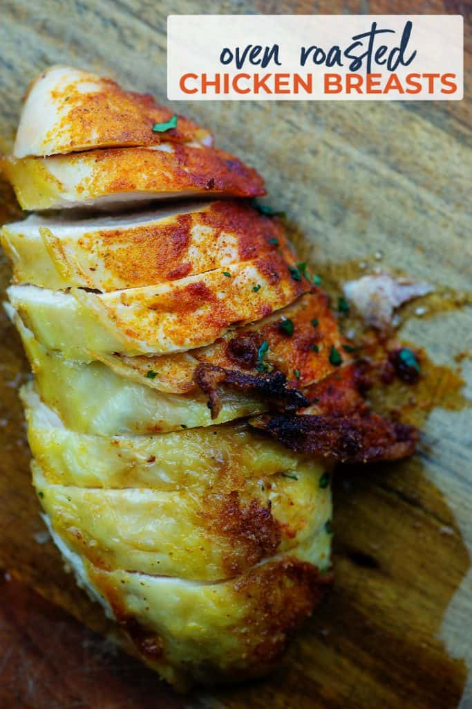 oven roasted chicken recipe on wooden cutting board