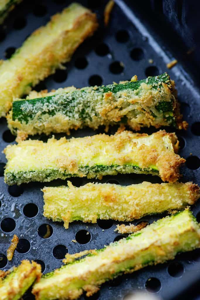 fried zucchini strips in air fryer basket