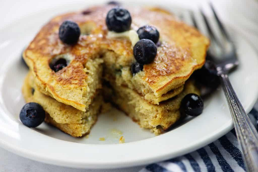 stack of cut pancakes with blueberries on top