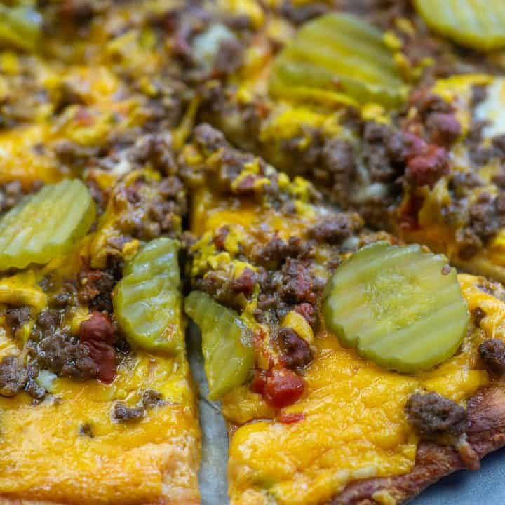 low carb cheeseburger pizza slices on pizza pan