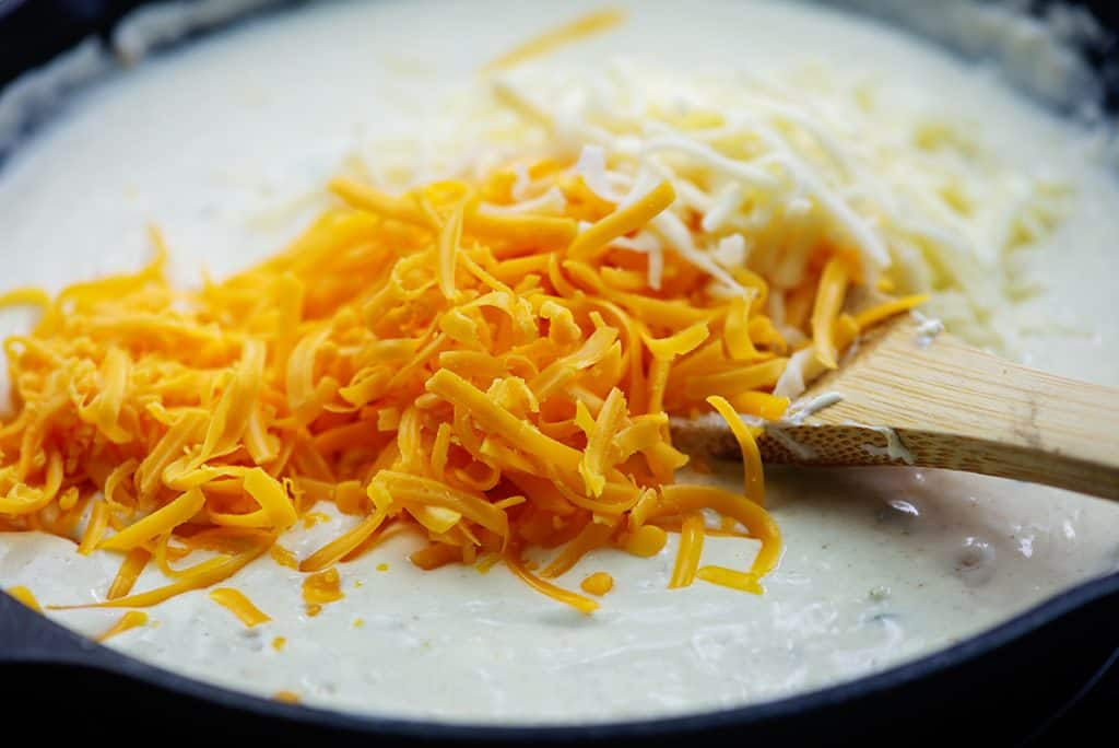 shredded cheese on top of cream sauce