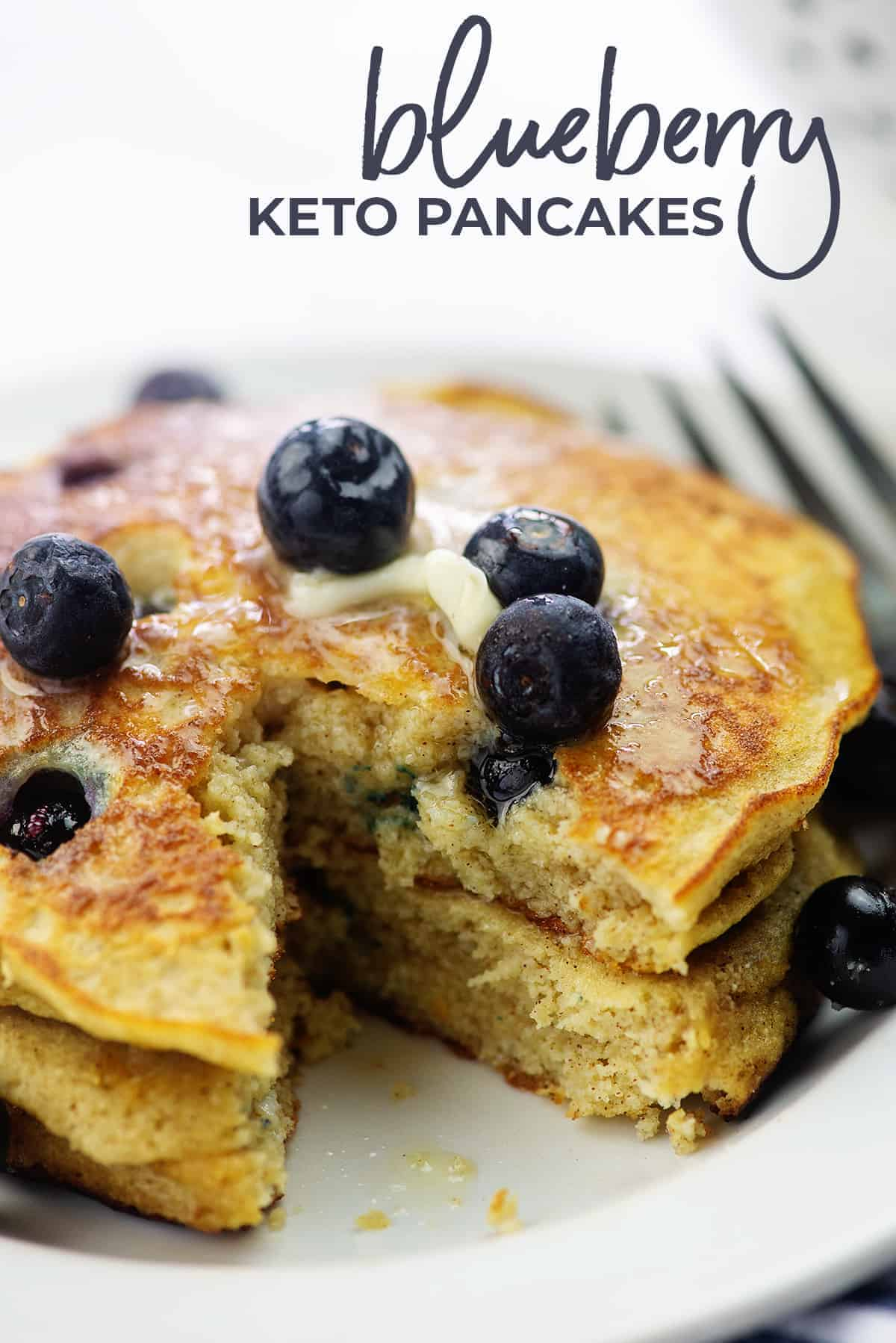 keto blueberry pancakes on white plate with fresh berries