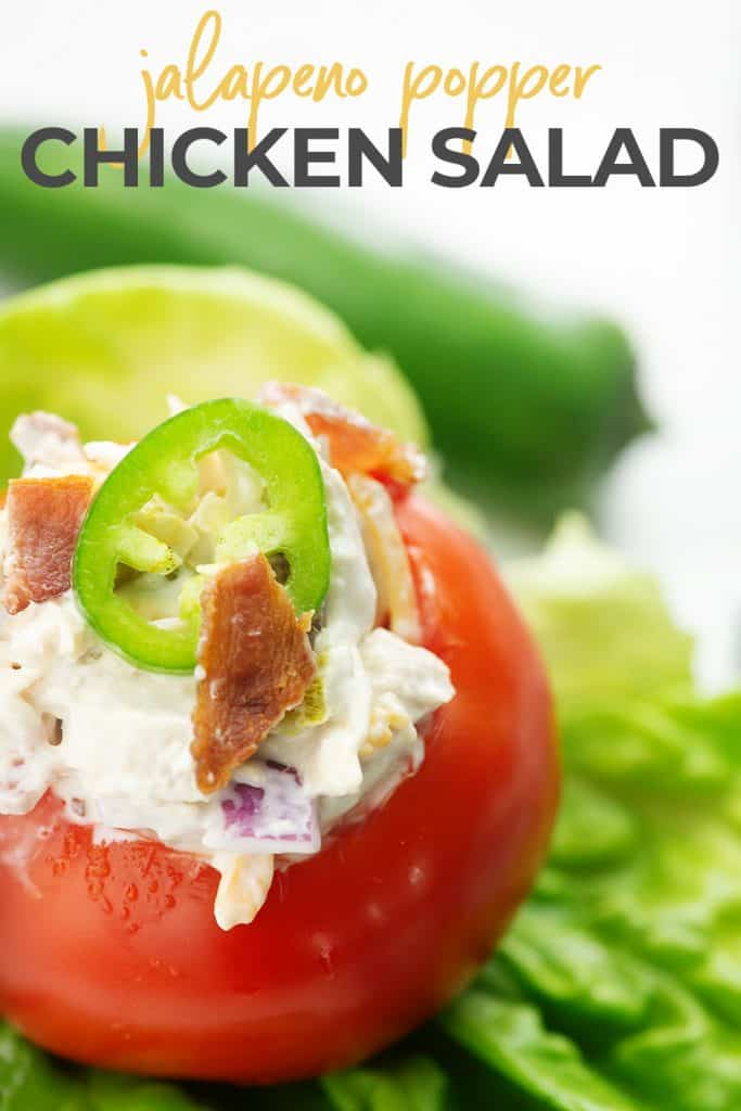 chicken salad recipe in a tomato on a bed of lettuce