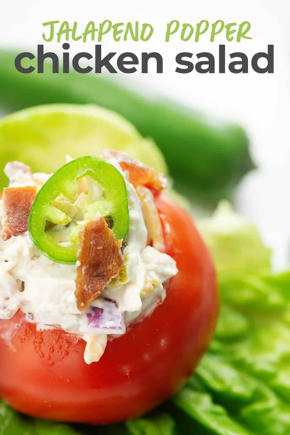 jalapeno popper chicken salad stuffed inside a tomato salad stuffed in tomato
