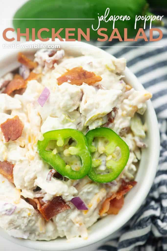 bacon and jalapeno chicken salad in white bowl with blue striped napkin