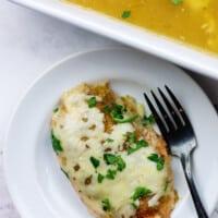 cheesy salsa verde chicken on white plate