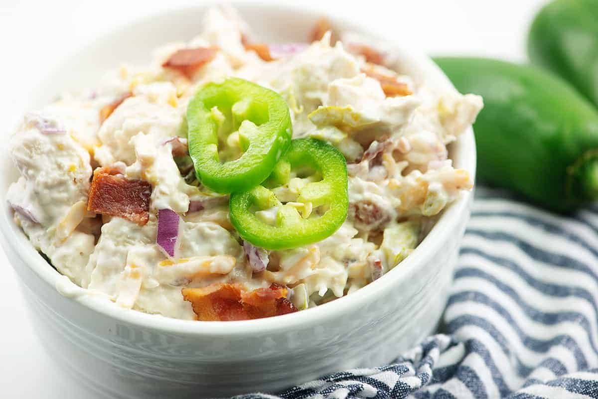 chicken salad with jalapenos and bacon in white bowl