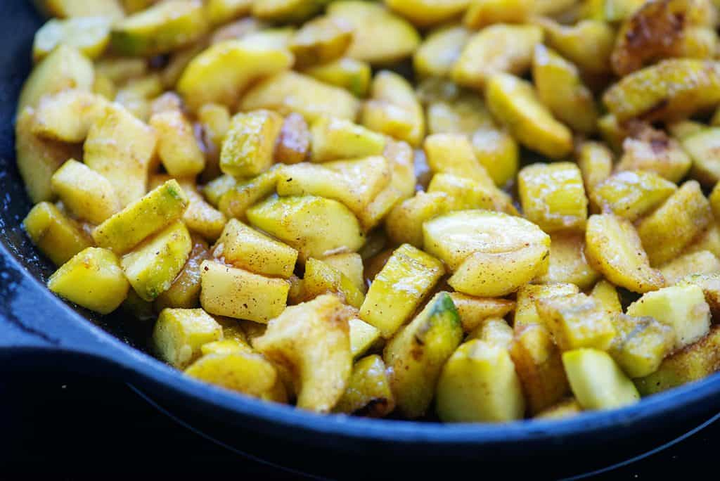 zucchini cooked in spices in cast iron skillet
