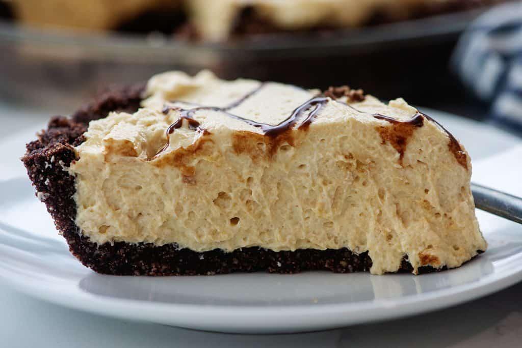 creamy peanut butter pie on white plate