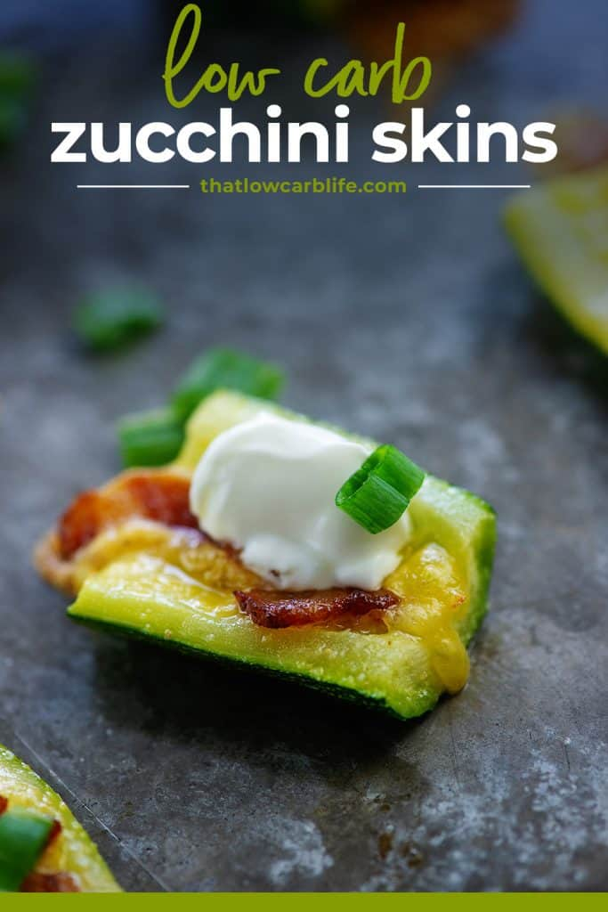 sliced zucchini topped with sour cream and cheddar