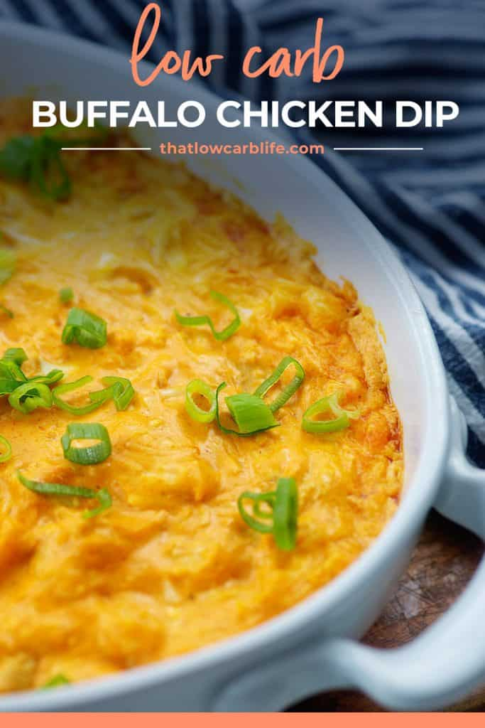 keto buffalo chicken dip in white baking dish topped with green onions