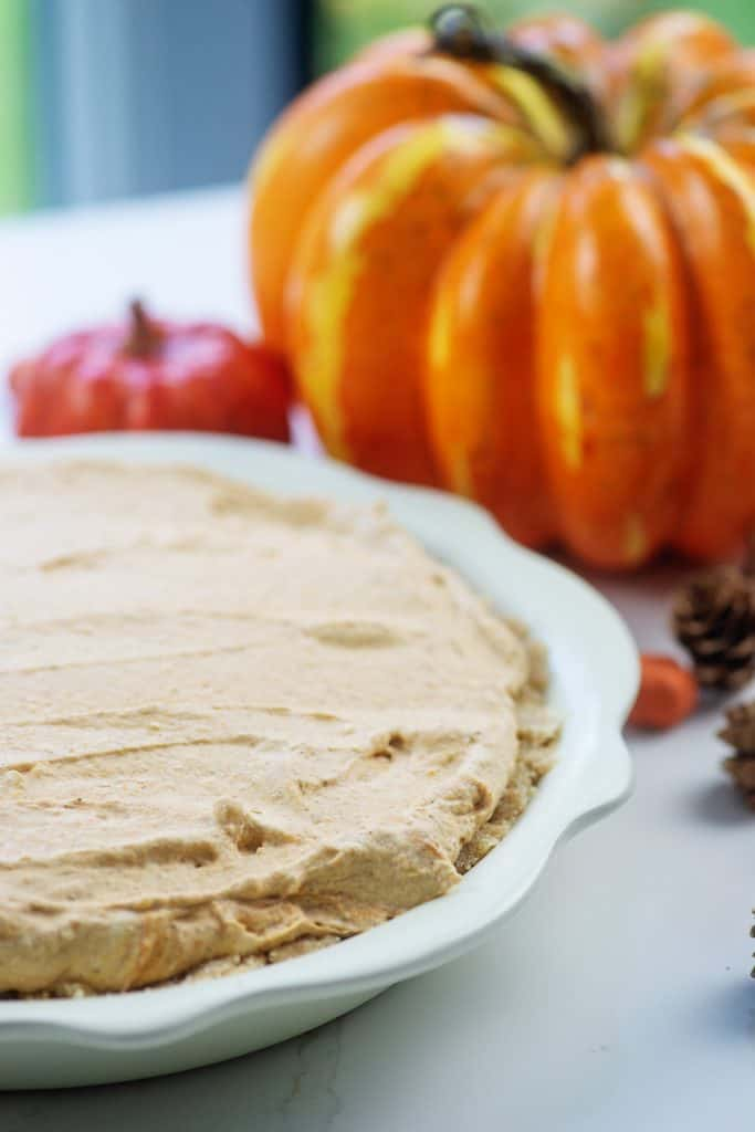 no bake pumpkin pie surrounded by pumpkins