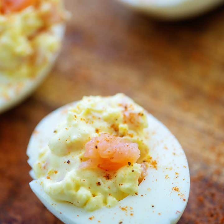 smoked salmon deviled eggs on wooden cutting board