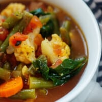 low carb vegetable soup in white bowl