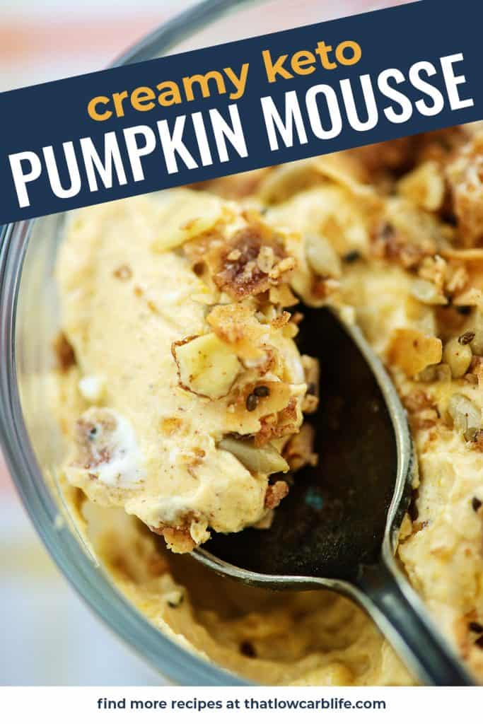 keto pumpkin mousse on spoon with crunchy granola on top