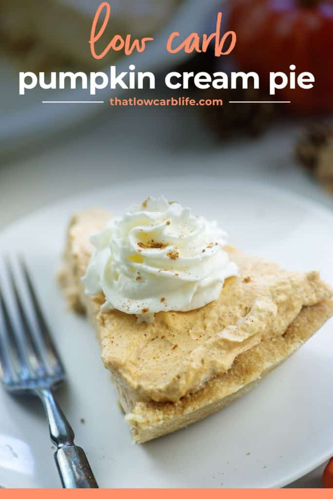 slice of pumpkin pie on white plate with whipped cream