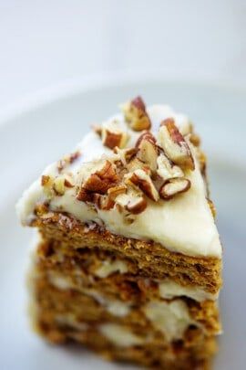 pumpkin layer cake with chopped pecans on top