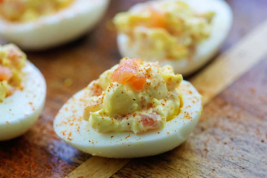 deviled eggs on wooden cutting board