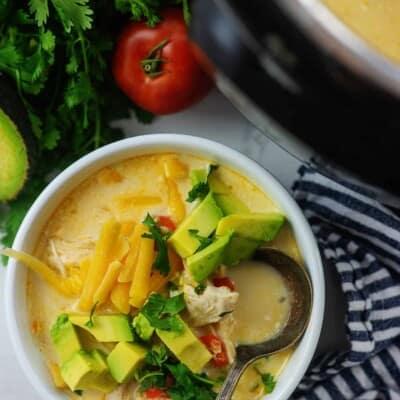 chicken fajita soup in white bowl