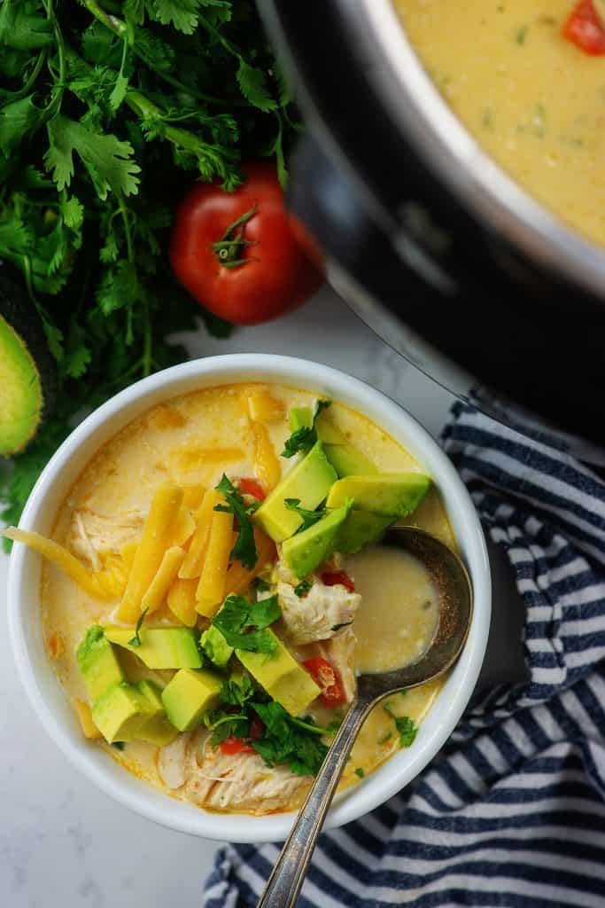 chicken fajita soup in white bowl