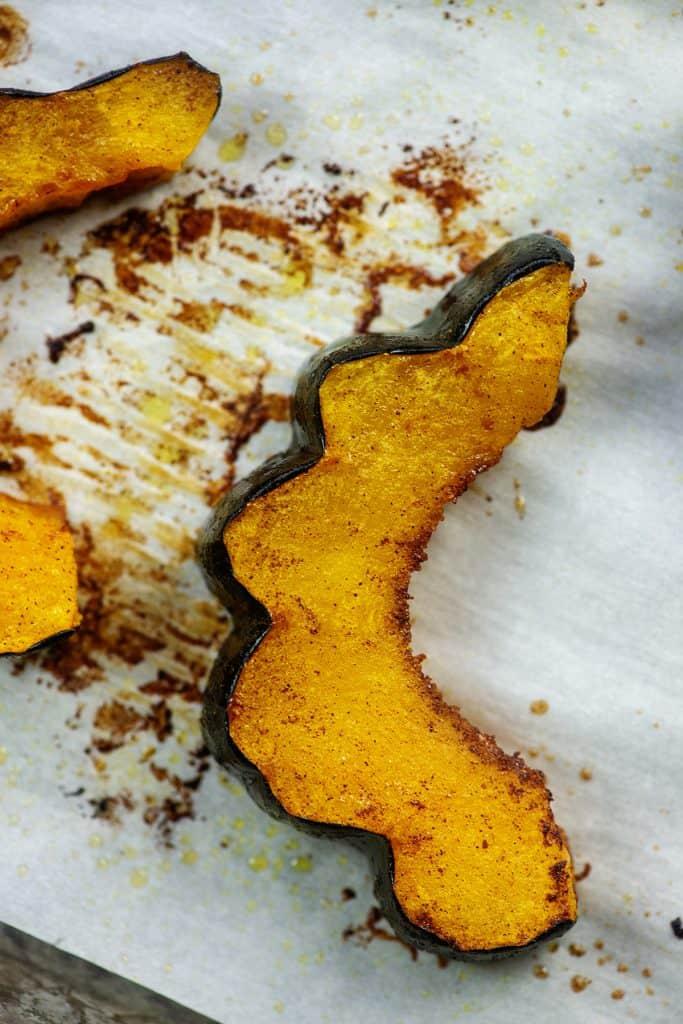 tender roasted acorn squash on baking sheet