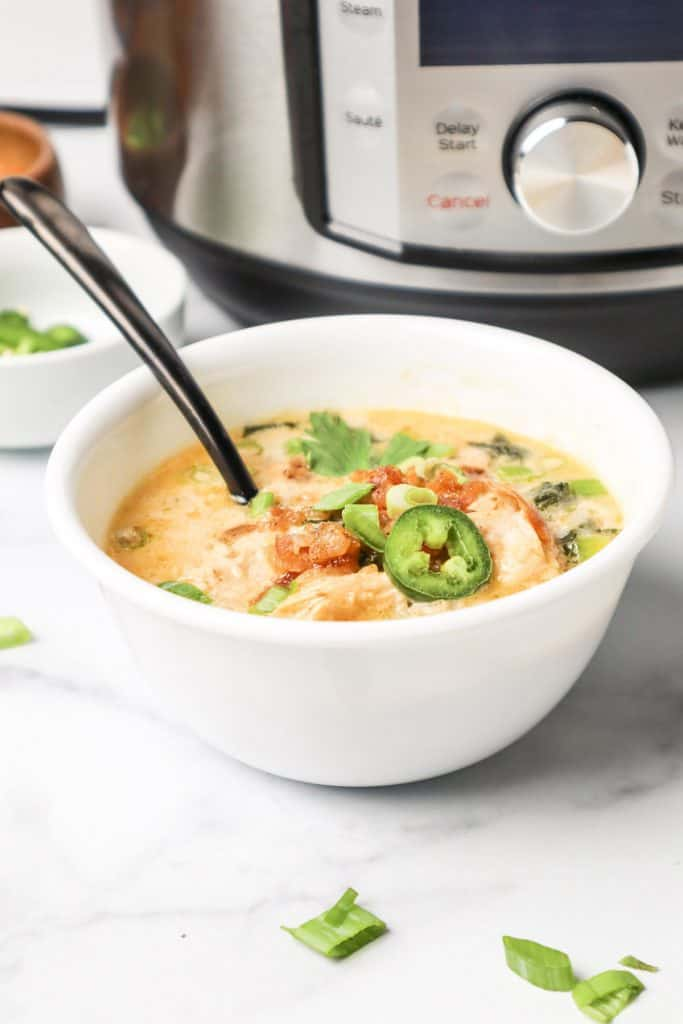bowl of cajun ranch soup in front of instant pot.