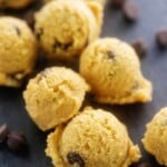 chocolate chip cookie balls on black surface.