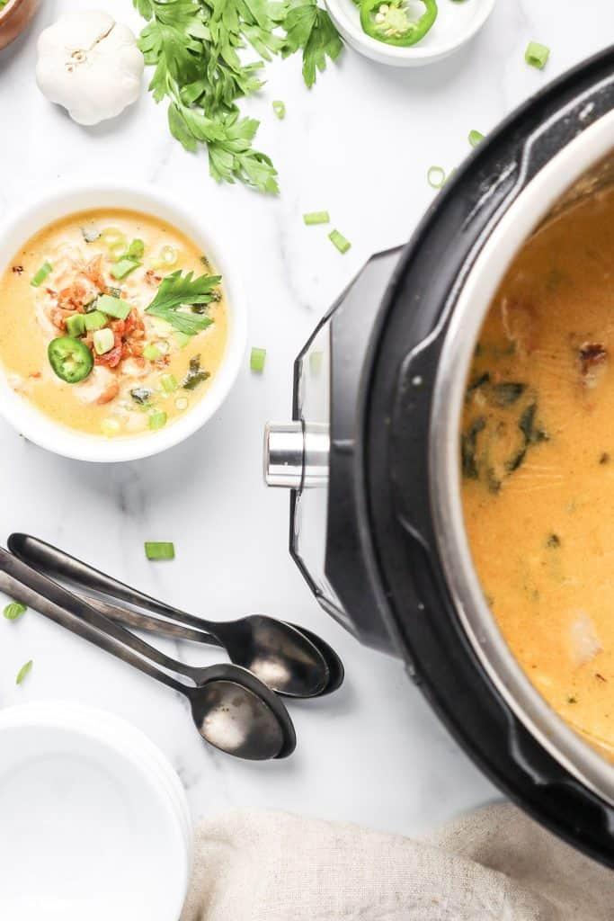 bowl of soup next to Instant Pot.