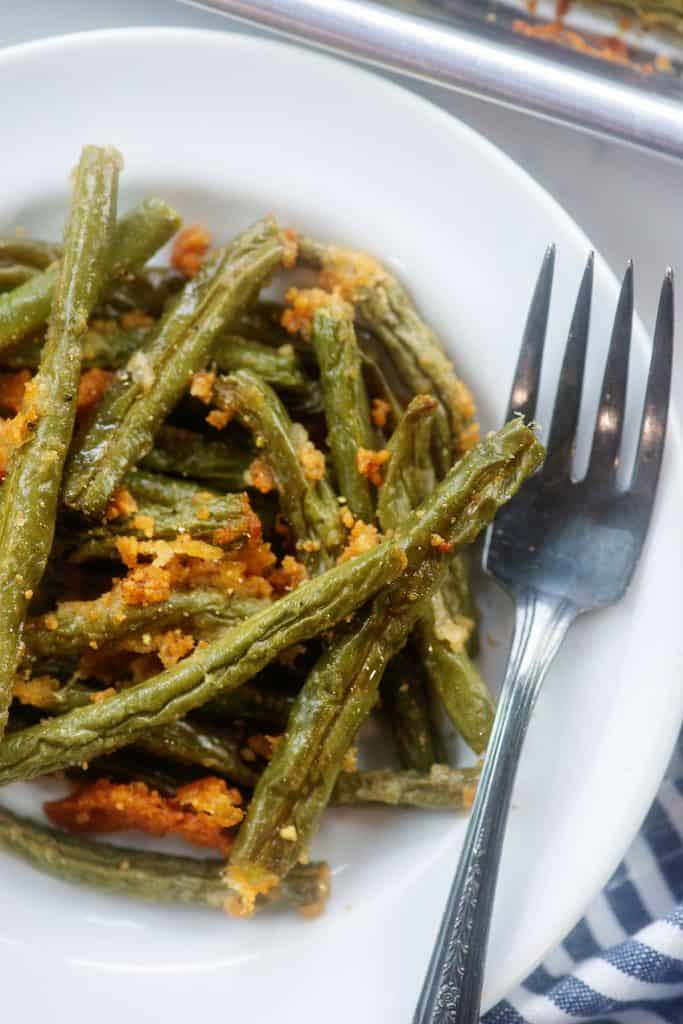 cooked green beans on plate.