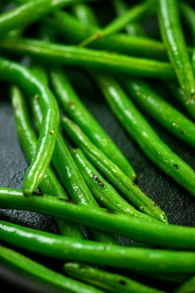 green beans in cast iron skillet.