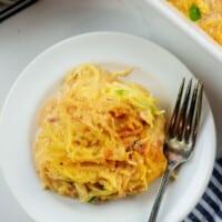 cheesy keto spaghetti squash recipe on white plate.
