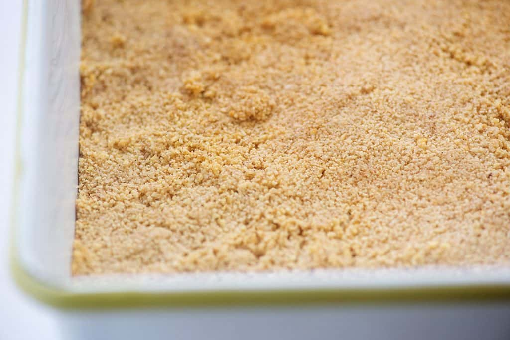 almond flour crust in white baking dish.