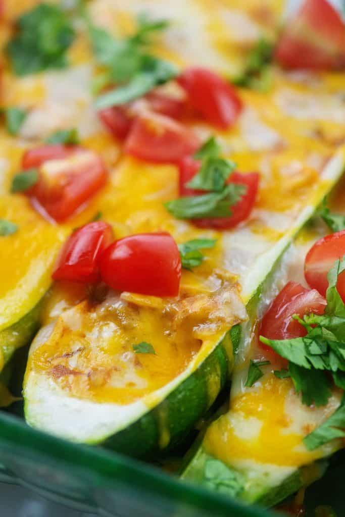 chicken enchilada zucchini boats in glass baking dish.
