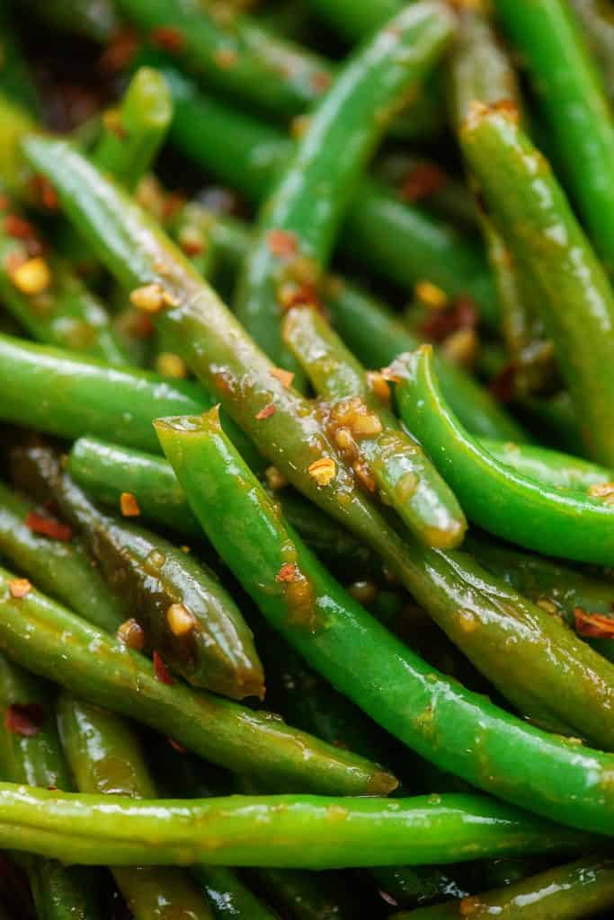 close up of Asian green beans with spices.